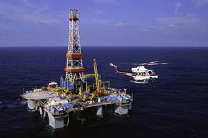 Transport helicopter at an offshore oil rig in the Gulf of Mexico