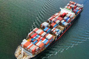 Cargo ship with packages on water