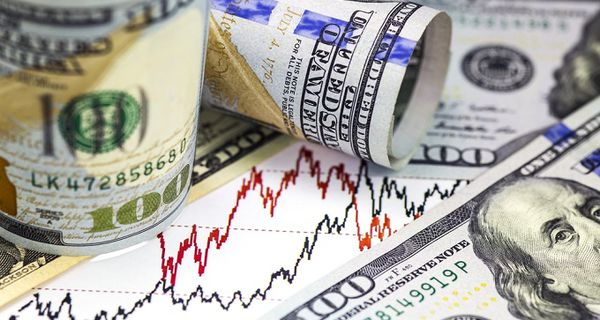 Image of stock charts and U.S. currency
