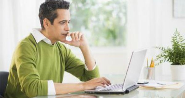 Man at computer looking thoughtful