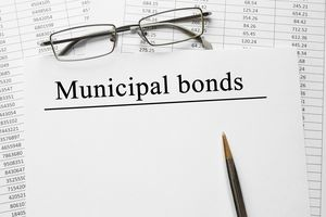 A paper with Municipal Bonds on a table.