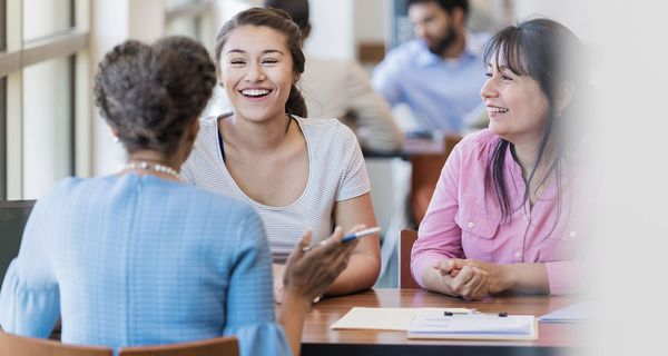 Loan officer discusses student loan with college student