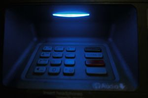 Close-Up Of Illuminated Blue Atm Keypad