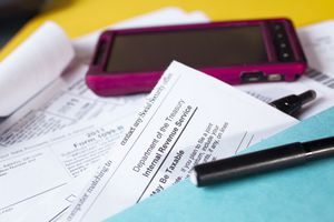 Tax papers with a cell phone on them
