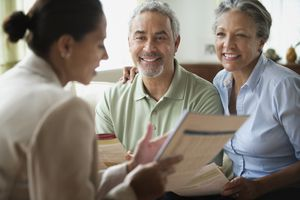 Saleswoman talking to clients in living room