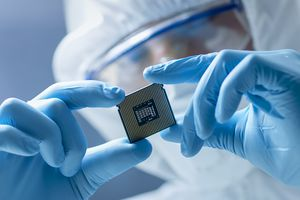 Worker Holding Micro Chip