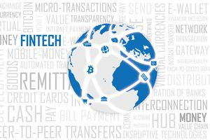 A globe resting on top of words related to fintech.