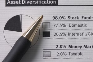 close up of a pen over a paper that shows a pie chart and asset diversification