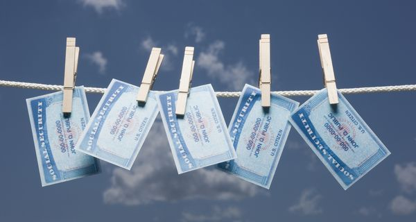 Social security cards on clothes line.