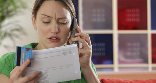 woman looking at credit report