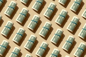 Rolls of American dollars on a beige background