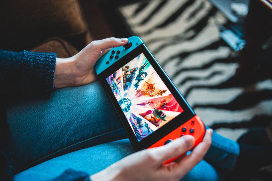 A person plays a Nintendo Switch in handheld mode