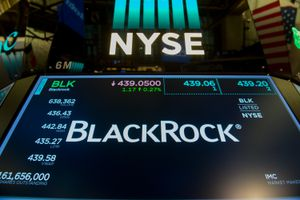 The trading symbol for BlackRock is displayed at the closing bell of the Dow Industrial Average at the New York Stock Exchange on July 14, 2017 in New York.