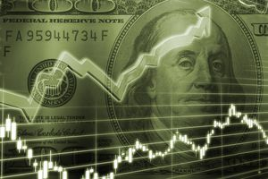 One hundred dollar bill with stock market chart
