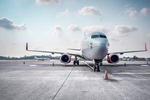Airplane on runway against sky.