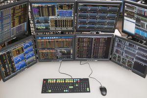 A desk with arrangement of computer monitors.
