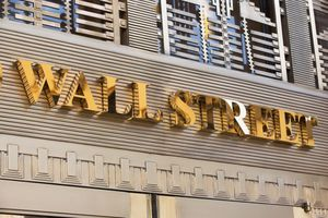 Gold Wall Street sign.