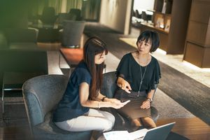 A woman seeks advice from young expert in the field of insurance an investments.