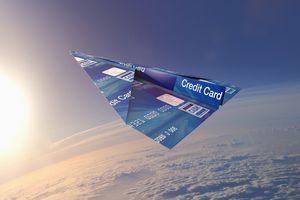 Credit card folded into paper airplane