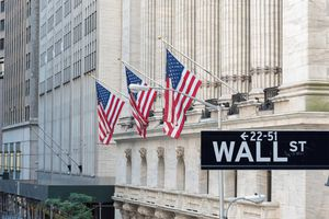 new york stock exchange with wall st sign