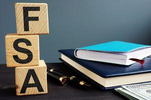 Flexible spending account FSA written on a wooden cubes.