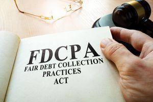 Fair Debt Collection Practices Act FDCPA on a table.