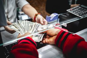 Person depositing money into the bank