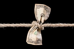 A dollar bill tied in rope