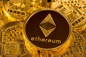 Stack of Ether coins with gold background