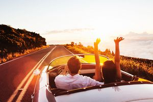 Couple on a road in a convertable car