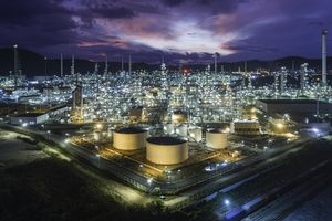 A large refinery lit up at night.