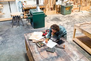 Designer Working at a Bench in a Furniture Factory