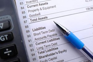 Financial Statement, Pen and Calculator on Table