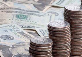 Twenty dollar bills and stacks of quarters and