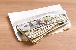 Envelope of dollar bills of various denominations