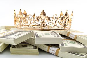 A crown on top of a pile of money