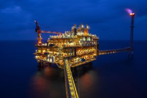 Petroleum production platform in offshore in oil industry at night.