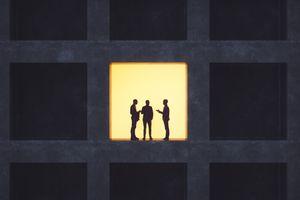 Businessmen talking in secrecy