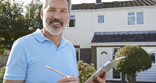 Home appraiser holding list outside home