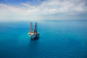 Aerial view of an offshore oil rig taken from a distance
