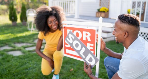Couple places sold sign on house for sale