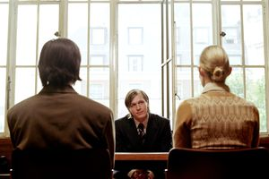 Couple seated at table in front of an arbitrator