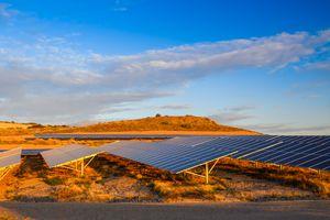 Solar panels in an orange desert landscape