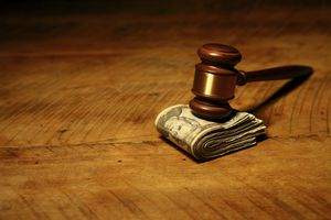 Gavel on top of pile of folded US currency