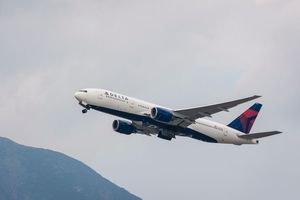 Delta Air Lines Boeing 777-232(ER) passenger plane belonging to the Delta Air Lines taking off at Hong Kong International Airport