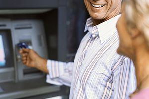 Older couple withdrawing money from an ATM