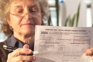 An adult woman looking at Social Security documents.