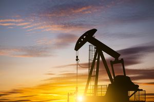 Oil pump with a sunset background