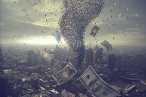 Tornado of money over cityscape.