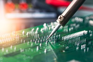 Technician Repairing the Computer's Circuit Board by Soldering